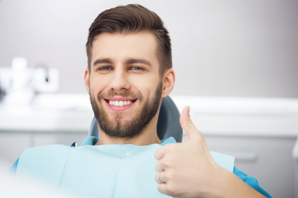 man smiling at dentist